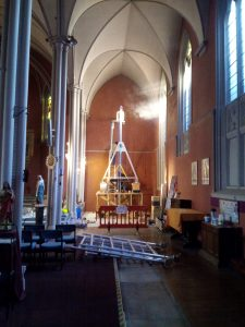 The calvary being fitted in its new dedicated chapel